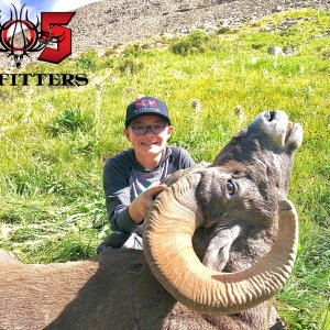 Happy Young Hunter with Trophy Ram